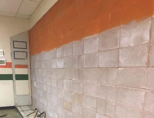 The walls inside the Galimore-Powell Field House are being sanitized to remove dirt, mold and mildew.