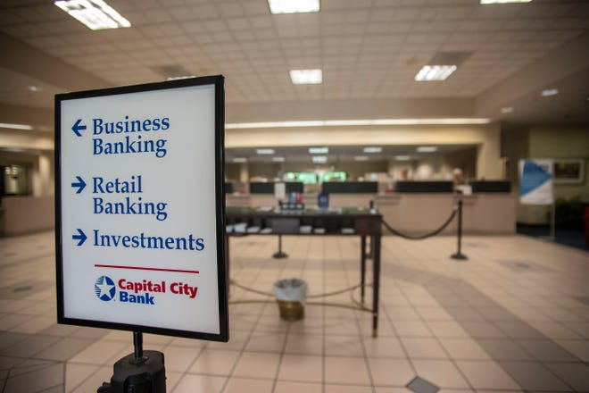 The lobby of Capital City Bank is closed but the drive thru windows are open for clients to conduct their banking.