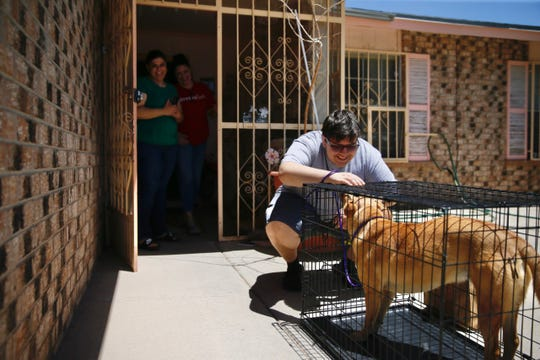 Ranfiel Encinas meets his new dog, Socorro, on Friday, May 22, in El Paso. El Paso Animal Services is making contactless pet adoption deliveries.