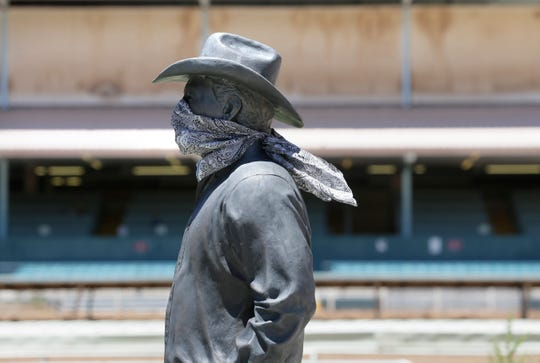 Even the statue in the infield at Ruidoso Downs was wearing a mask. The 2020 racing season is underway at Ruidoso Downs Racetrack in Ruidoso, NM. The track is starting the season without fans in the stands due to coronavirus.