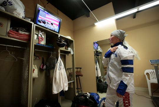 Jockey Tami Purcell holds her hand over her heart during the National Anthem Friday at Ruidoso Downs. The New Mexico horse racing industry is hold live races for the first time since mid-March when Sunland Park & Casino was shutdown because of the coronavirus.
