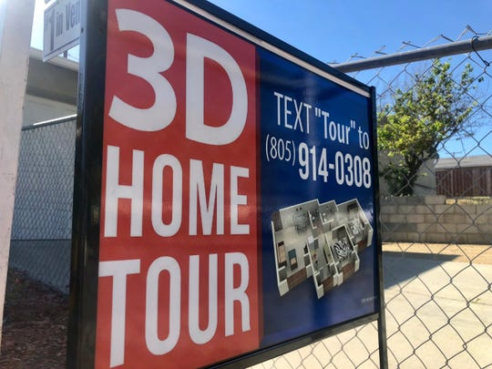 A sign advertises a 3D home tour in front of a home for sale in Ventura. Real estate agents are increasingly using 3D home tours to fill the gaps caused by canceled open houses and limited showings during the coronavirus outbreak.