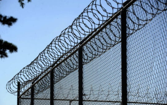Barbed wire and chain-link fence surrounds the Ventura Youth Correctional Facility at  3100 Wright Road in Camarillo.
