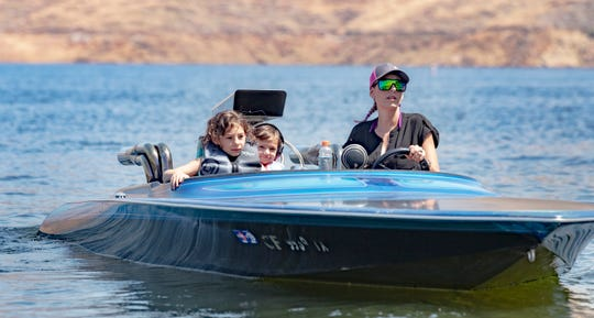 Rebecca Beukelmen idles around the Lemon Hill boat ramp with Khloe Viera, 7, and her sister Olivia Viera, 4 at Lake Kaweah on Friday, May 22, 2020.  The marina reopened today after closing amid COVID-19 concerns.