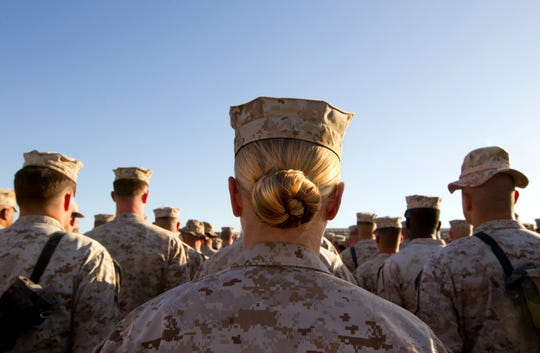 Marines stand in formation during a ceremony in November 2010 at Camp Delaram in Helmand province, Afghanistan.