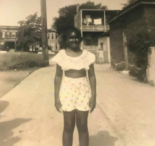 A young Rhoda Hatch stands near her home in Chicago, Ill.