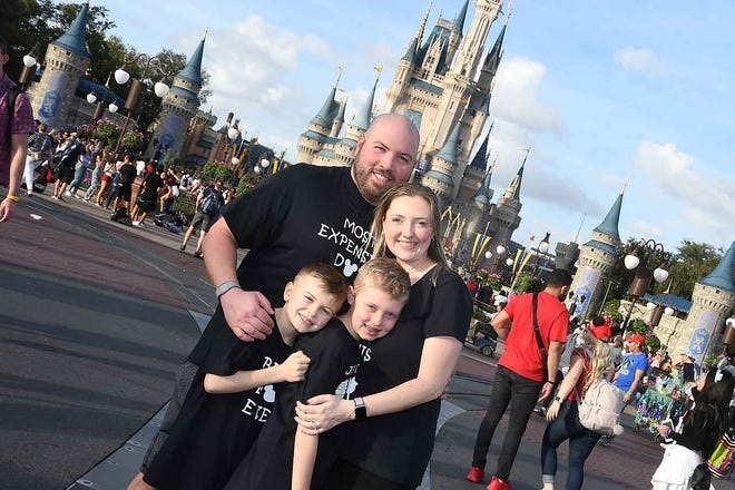 Mike McMahon, pictured here with his family at Disney World, is convinced he got the coronavirus shortly after his trip. (Mike McMahon/Courtesey)
