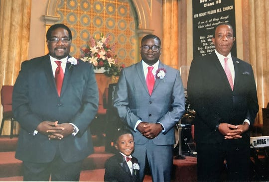 Larry Harris (right) is the best man for Marshall Hatch (left) for his wedding vow renewal in Chicago, Ill. in Sept., 2003. Hatch's nephew, Lil Rel Howery (center), and Howery's son attend the renewal.