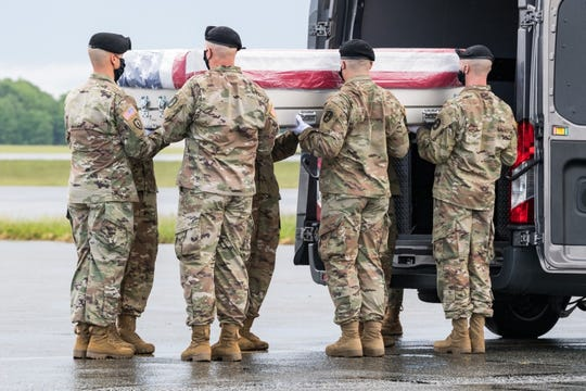 A U.S. Army carry team transfers the remains of 1st Lt. Trevarius R. Bowman, of Spartanburg, South Carolina, during a dignified transfer May 23, 2020, at Dover Air Force Base, Delaware. Bowman was assigned to Company B, 198th Signal Battalion, 261st Signal Brigade, Newberry, South Carolina. The unit is attached to the 228th Theater Tactical Signal Brigade, South Carolina National Guard.