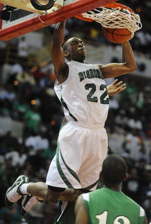 Peabody's Markel Brown dunks in the second half against Bossier during a 2010 game at the Cajundome. Peabody defeated Bossier 61-58 in the Class 4A State High School Championship game.