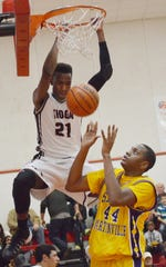 Tioga senior forward Aaron Epps (21) dunks during a playoff win over St. Martinville in 2014. The 6-foot-9 LSU signee averaged 22 points, 11 rebounds and almost 7 blocks en route to being named The Town Talk's 2014 All-Cenla Boys Basketball MVP .