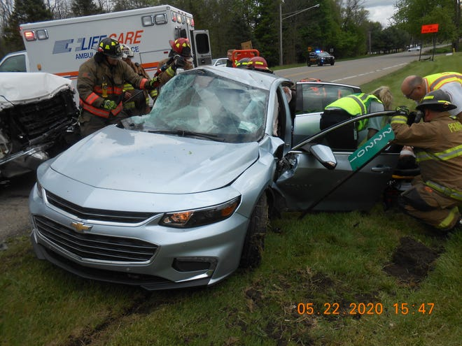 Rescue workers free victims of a crash Friday in Pennfield Township.  Provided