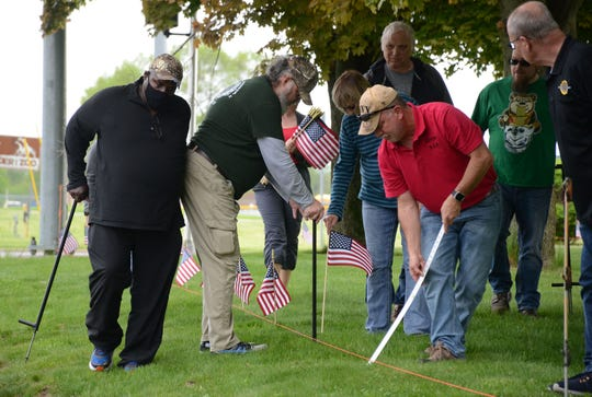 Members of the American Legion Post placed 144 flags along B Drive North and Beadle Lake Road on Friday. Trace Christenson/The Enquirer