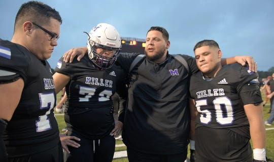 Ruben Garcia talks to his offensive line athletes after the game against Veterans Memorial, Friday, Nov. 29, 2019, at Buc Stadium. Garcia announced he will be the new athletic director and head football coach for Falfurrias High School.