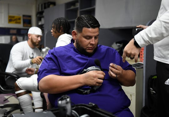 Ruben Garcia prepares his headset before the game against Veterans Memorial, Friday, Oct. 26, 2019, at Buc Stadium. Garcia announced he is the new athletic director and head football coach for Falfurrias High School.