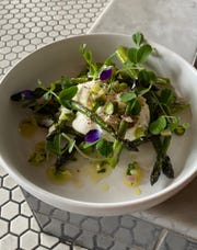 Fresh Asparagus is served with Burrata, pea shoots and edible blossoms at Farm & Fisherman Tavern in Cherry Hill.