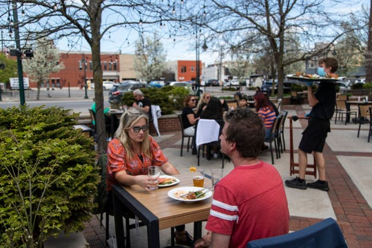 Chera Rizk and her boyfriend Jeremy Gonsior, both of Holland have lunch at the Towne Plaza in Traverse City on May 22, 2020.