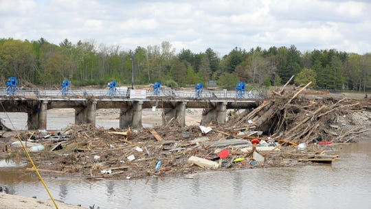 The Sanford dam sits damaged after failing to hold back the Tittabawassee River on May 23, 2020.
