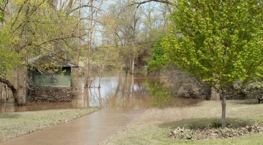 This path near the Currie Parkway Bridge runs along the Tittabawassee River and is commonly used by walkers, runners and bicyclists. The area, not far from Dow Gardens, is flooded and inaccessible since the dam failures the week of May 18, 2020.