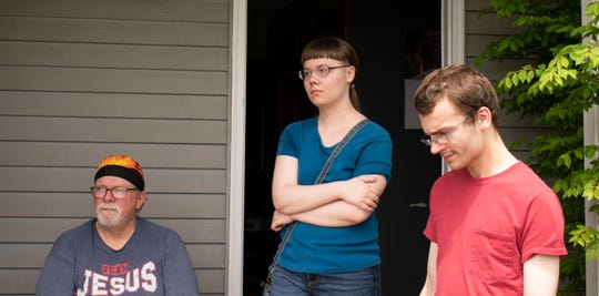 From left, Jeremy McRoberts, Rebecca McRoberts and Jeremy McRoberts can't decide if the house where the family lives is safe after sewage mixed with floodwater all the way up the third step on the staircase. They had just returned home after the water receded on May 22, 2020.