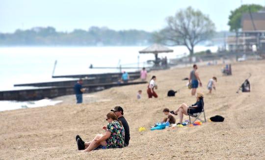 Groups maintain social distance at Lakeside Park beach.