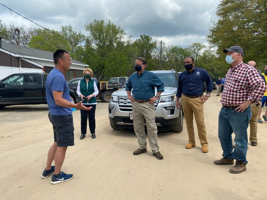 U.S. Senators Debbie Stabenow, second from left, Gary Peters, center, and U.S. Rep. John Moolenaar, right, visited Midland on Saturday, days after the Edenville and Sanford Dams to failed, causing widespread flooding throughout Midland County.