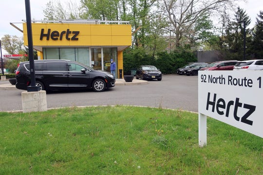 FILE - In this May 6, 2020, file photo, a Hertz car rental is closed during the coronavirus pandemic in Paramus, N.J. Hertz filed for bankruptcy protection Friday, May 22, 2020, unable to withstand the pandemic that has crippled global travel and with it, the heavily indebted 102-year-old car rental company's business.