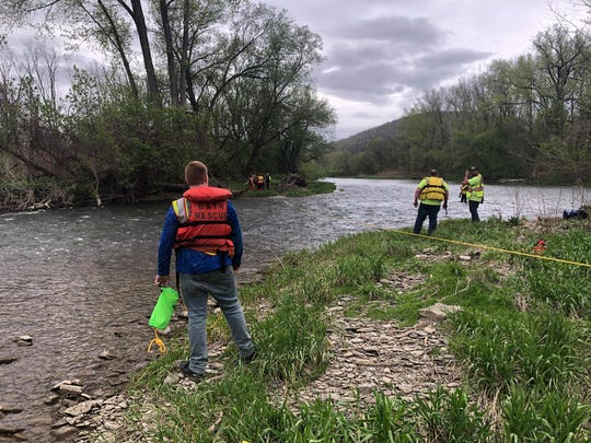 Four people were rescued from an island in the Cohocton River in Bath after getting trapped amid shallow, but fast-moving waters Friday, May 22, 2020.