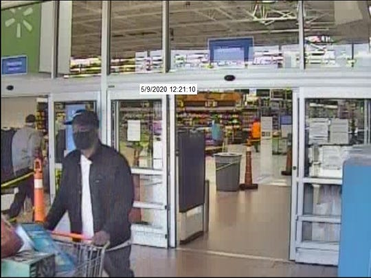 Police are looking for a man who used fake $100 bills at the Bellevue Walmart on May 9.