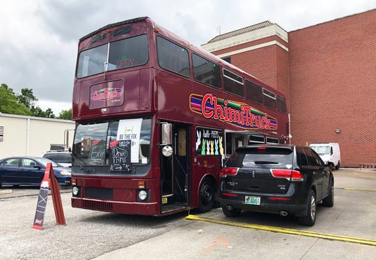 A customer pulls up to the Tacoholics ChimiTruck, a double-decker bus that has been converted into a food truck. Restaurant owner Marcos Nicolas since March has parked the vehicle in his side parking lot at 122 First St. in Henderson. to serve as a drive-through window, Food is cooked inside his main kitchen and are usually ordered and paid for in advance by phone or text.