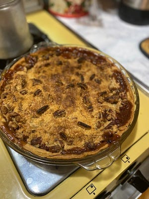 Chef Anne presents an apple pie with Streusel topping.