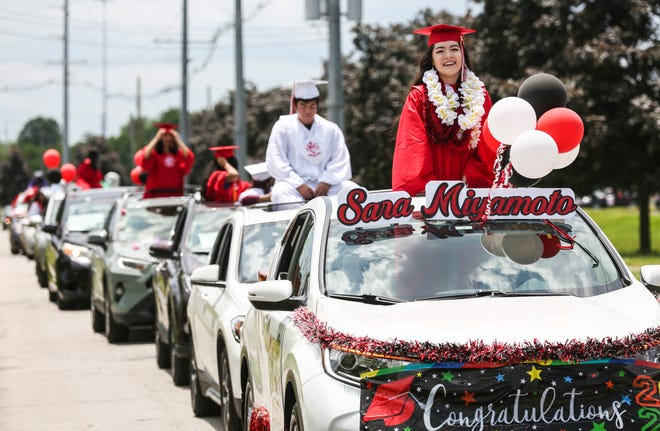 Many graduating seniors in the 2020 duPont Manual High graduation parade rode perched through a sunroof Saturday afternoon.  May 24, 2020