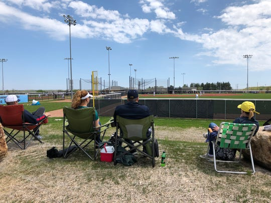 Families enjoy watching youth baseball at Rock Sports Complex in Franklin on Saturday. Many communities in Milwaukee County have been slowly opening up.