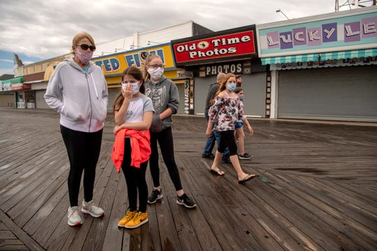 (From left) Sue Corbett, of Yonkers NY, and her grandchildren Julia Burke, 10, and Michaela Burke, 12, on the Seaside Heights boardwalk on Saturday, May 23, 2020.