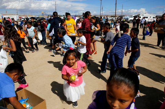 A group of kids search for healthy food and snacks during a food scramble hosted by the Navajo Nation Department of Behavioral Mental Health Services on Oct. 4, 2018 during the Northern Navajo Nation Fair in Shiprock.