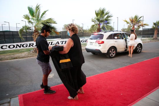 Xavier College Preparatory High School celebrates its graduating senior class with a drive-thru graduation ceremony due to the coronavirus pandemic on Friday, May 22, 2020 in Palm Desert, Calif.