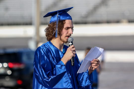 Pensacola Private School of Liberal Arts senior Sean McMann expresses his gratitude to the school during commencement at Five Flags Speedway on Friday.