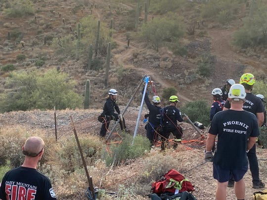 Crews attempt to rescue a 17-year-old boy from a mine shaft near New River on May 22, 2020.