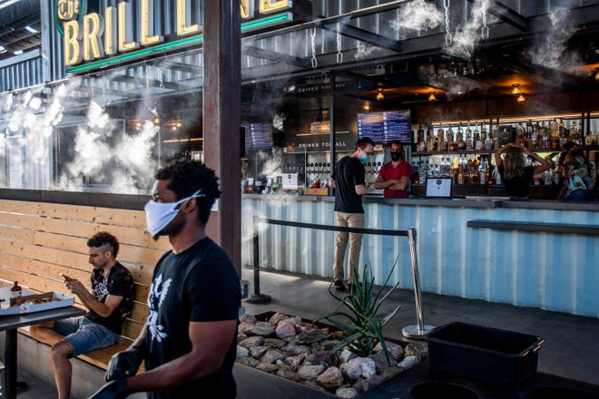 Employees and some customers wore masks at The Churchill in Phoenix on May 22, 2020.