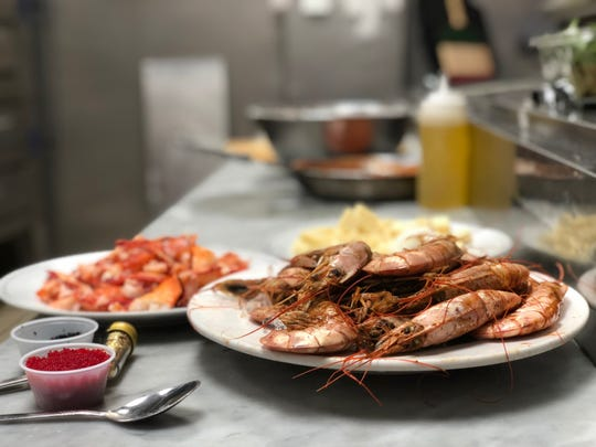 Tiger prawns, lobster, sturgeon caviar and edible gold flake are just a few of the ingredients in Divino's $400 pie, given away for free Friday, May 22, 2020.