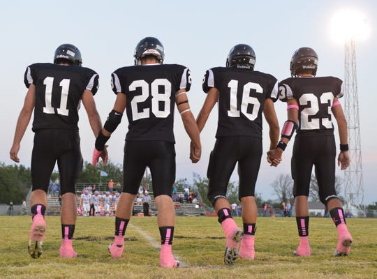 Water Valley Wildcat captains (from left) Brock Demere, Colt Riley, Colten Zuniga and Kellen Kirkland take the field for the coin toss before their meeting with Borden County in 2012.