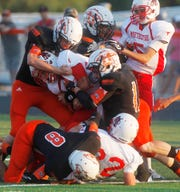 A Meeteetse player is wrapped up by Robert Lee defenders on Aug. 30, 2013.