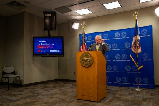 Gov. Tim Walz removes his mask before announcing new guidelines for religious services  during a news conference at the Department of Public Safety in St. Paul, Minn.  on Saturday, May 23, 2020.  Minnesota health officials are reporting a record high for COVID-19 cases for the second straight day. (Evan Frost/Minnesota Public Radio via AP)