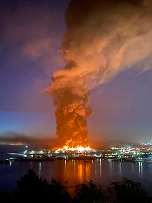 This photo courtesy of Dan Whaley, @dwhly, shows a warehouse fire burning at San Francisco's Fisherman's Wharf in San Francisco early Saturday, May 23, 2020.  The fire tore through the warehouse, sending thick smoke over the waterfront and causing its walls to collapse.