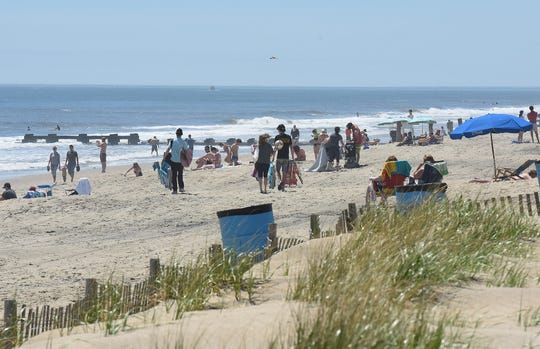 Crowds were down on the Saturday of Memorial Day weekend as visitors slowly came out to the reopened beach and boardwalk in Rehoboth Beach.