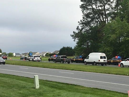 Cars wait to pass through a checkpoint on Route 1.