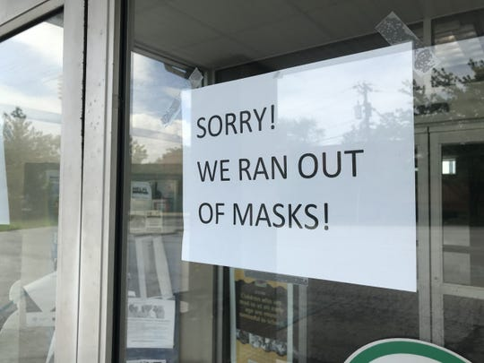 A sign on the North Wilmington Branch of the Wilmington Public Library indicates the popularity of a facemask giveaway program which distributed 20,000 masks in the city Saturday.