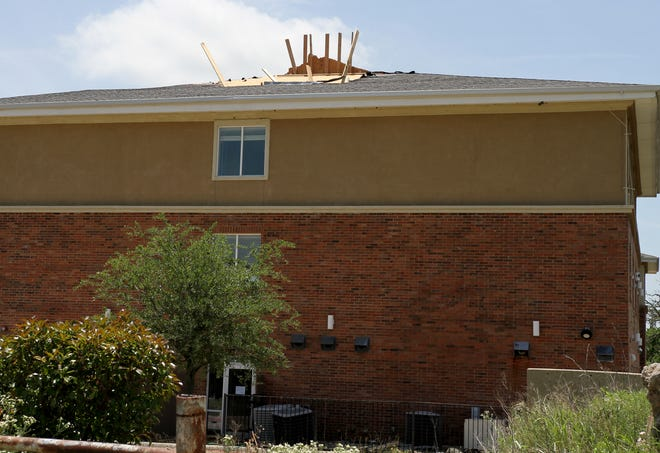 Roof damage is seen at a Best Western hotel in Bowie after a tornado tore through the town last week. The BBB said homeowners should be wary of fraudulent roofing contractors who can flock to areas after storms offering fast, cheap repairs for a high down payment.