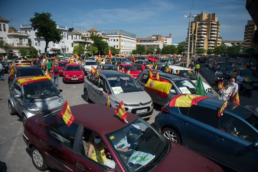 Demonstrators take part in a