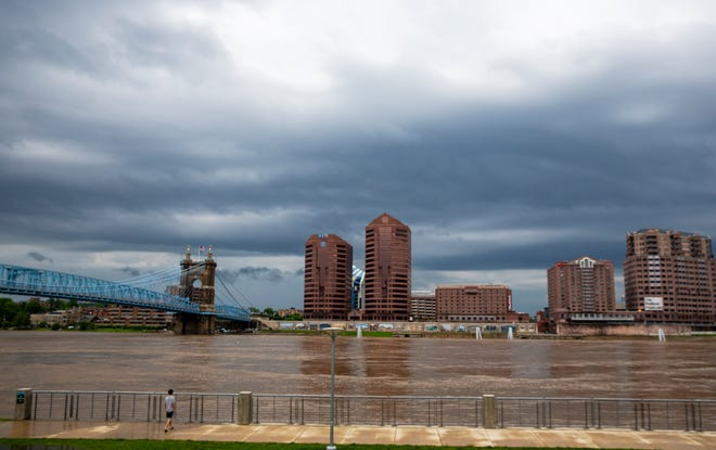 Dark skies hang over the Ohio River near Smale Riverfront Park at The Banks after storms paused Saturday, May 23, 2020.